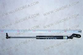 Амортизатор двери багажника K.SPORTAGE GRAND до 04г. (0K01G-62610E) RH